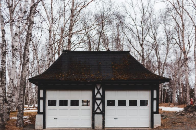 Common Garage Door Repairs and When to Call the Professionals